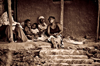 Black & White portrait photo for sale of African family on a home treshhold