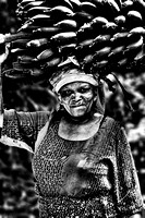 BW portrait of an old Woman carrying ש Banana cluster on her head on the way to the market in Marangu, Tanzania